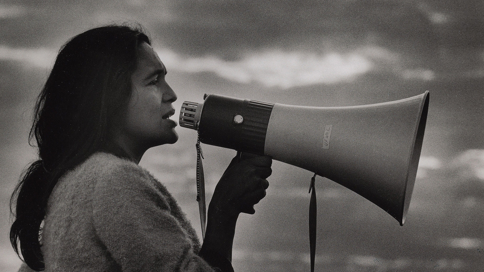 A young Dolores C. Huerta speaks into a bullhorn